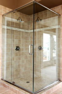 Bathroom remodeling with new glass and beige tiles