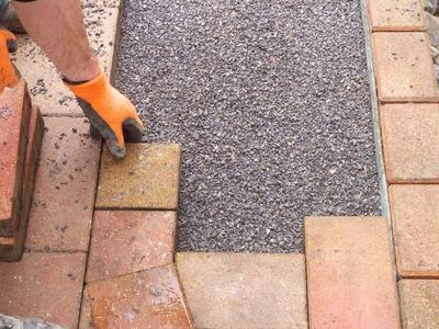 Installing paving stones over asphalt