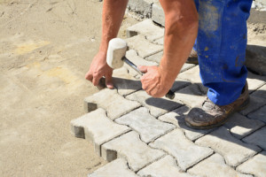 Showing how to install interlocking paving stones
