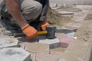 Installing paving stones on concrete